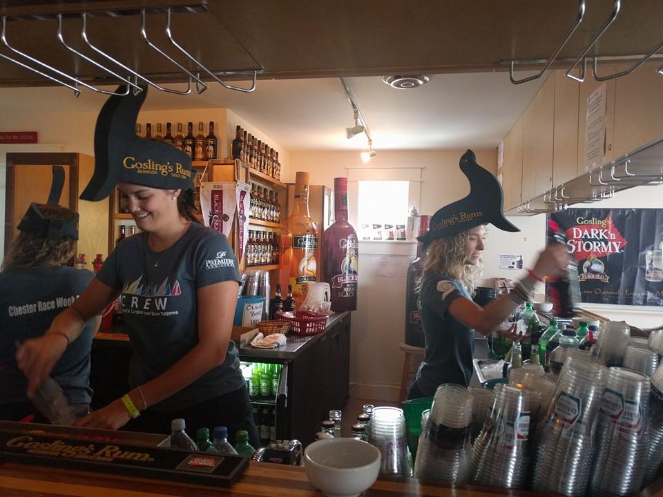 Bartenders wearing Gosling's hats serving drinks