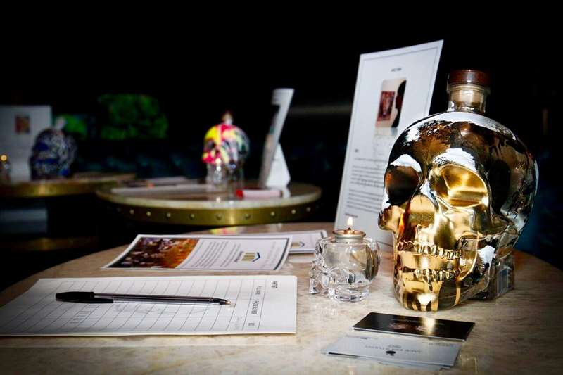 Crystal Head Aurora bottle on table