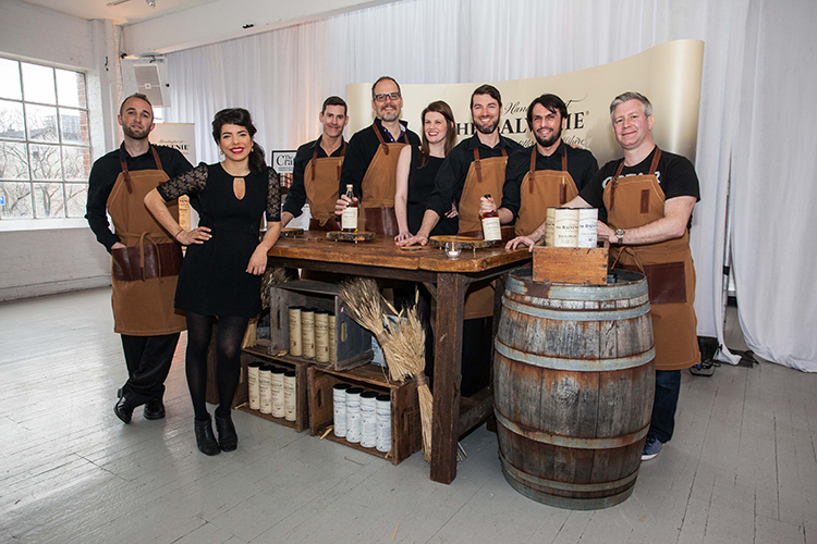 Bar tenders posing with bottles of The Balvenie