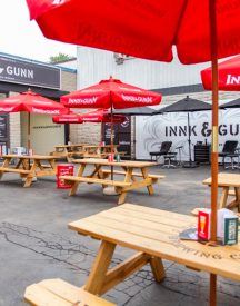 Innis & Gunn picnic tables with umbrellas