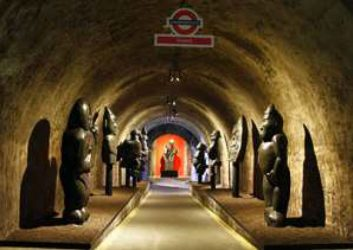 Tunnel lines with stone statues