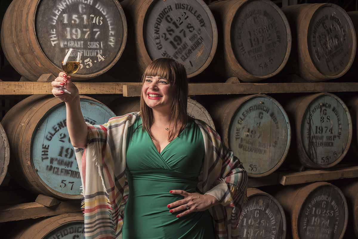 Elizabeth Havers posing with whisky